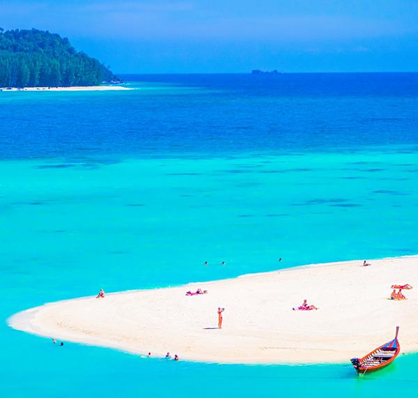 Tiny people at Sunrise Beach Ko Lipe Thailand
