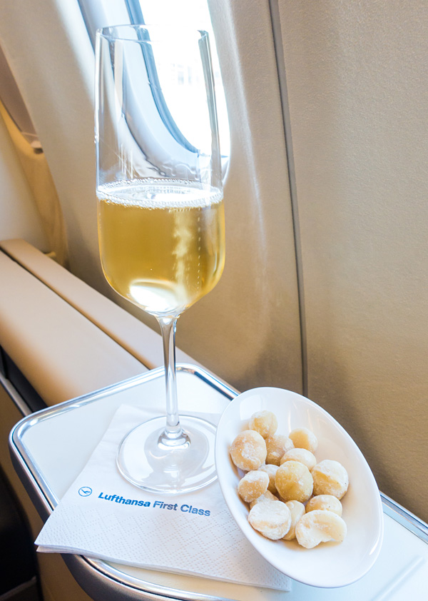 Lufthansa First Class 2007 Vintage Brut Champagne Louis Roederer with macadamia nuts