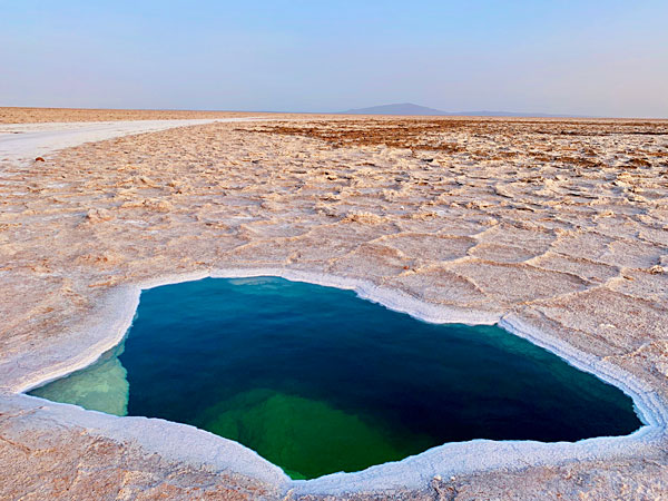 Salt water pool in the middle of the Ethiopian desert Afar region